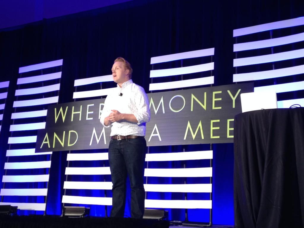 Jeff Goins on stage at FinCon14